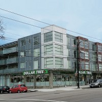 This purpose-built apartment building, with ground floor retail, at 2215 East Hastings Street in Vancouver is one of two similar buildings up for sale via broker HQ Commercial. (Image courtesy HQ Commercial)