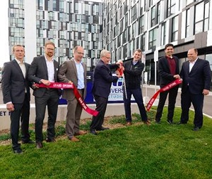 IMAGE: The ribbon cuttting for University Studios in Oshawa, Ont. From left,  Podium Developments' VP construction James Wilkinson; VP  development Christian Huggett; managing director, Oskar Johansson;   Oshawa Mayor John Henry; Podium managing director Bernard Luttmer; Building Capital CEO Saqib Qureshi and Varsity Properties' President A.J. Keilty.  (Photo courtesy Evan Eisenstadt)