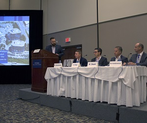 IMAGE: From left, moderator Lindsay Hockey, panelists Brent Arseneau, Dan Gray, Marc Shank and Martin Vandewouw discuss suburban office markets at the Ottawa Real Estate Forum. (RENX photo, Marc Shaw)